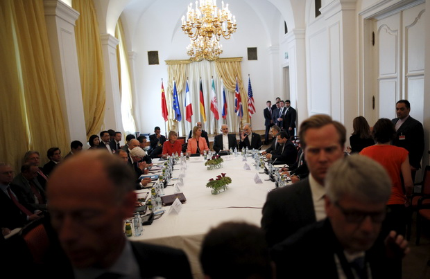 Iranian Foreign Minister Zarif sits next to EU High Representative for Foreign Affairs and Security Policy Mogherini as they meet with foreign ministers at the hotel where the Iran nuclear talks meetings are being held in Vienna