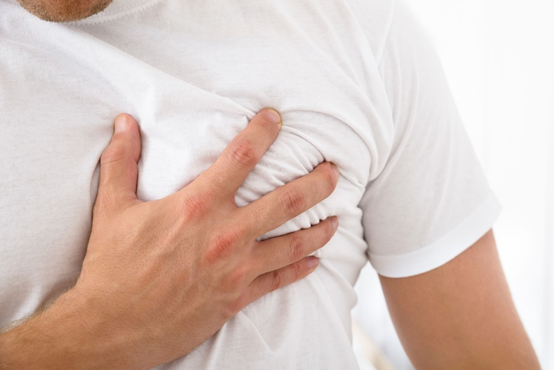 35943685 - close-up of a man suffering from chest pain