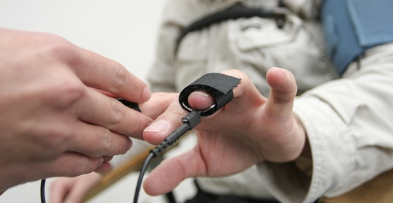 Placing equipment for interrogation of a man with lie detector.